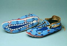 Circa 1880 Sioux moccasins with beaded soles, split tongues and tincones