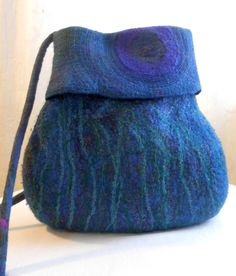Cauldron bag with yarns and silks and hand-stitched cuff, seamlessly felted. starjumparts.com