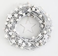 This is a really unique wreath! It's made of birch branches, hearts and stars and glass balls, all painted white! On Etsy by Botanika Studio.