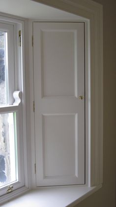 Traditional timber sash window shutters