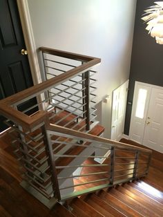 Custom stainless steel horizontal railing with walnut handrail made by Capozzoli Stairworks .Contact: 609-635-1265, capozzoli@comcast.net, website www.thecapo.us