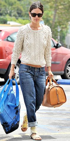 RB in  a cozy cable-knit sweater and pegged jeans