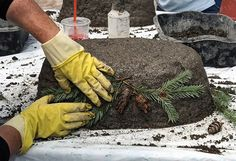 Hypertufa is made from a mix of one part Portland Cement, one part peat moss and one part vermiculite or perlite. Mix the dry ingredients together. Gloria Wright / The Post-Standard