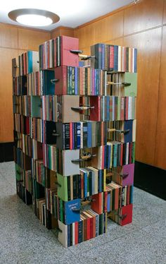 "sweethomestyle:    booklover:(via libraryland)    Cool way to make a back drop or arrange ""book blocks"" to make a table."