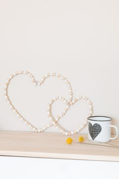 Pearl wood heart to decorate your home sweet home I Valentines Bricolage, Valentines Diy, Diy And Crafts, Crafts For Kids, Heart Diy, Deco Boheme, Christmas Ornaments To Make, Art N Craft, Beaded Garland