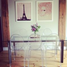 Lucite chairs, glass table with natual wood