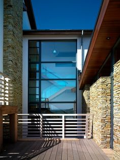 Trendy Coastal House Equipped with Indoor Swimming Pool : Astonishing Deck Metal Balustrade Modern Coastal House Exterior Design Using Expos...
