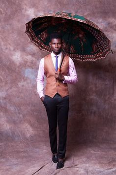 Emerging African Fashion Designer Is Raising The Bar For Menswear Fashion. Tailored Suites And Exquisite Colors Is A Sure Show Stopper.