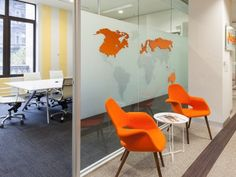 Love the world map isolated images in a fun color. Love these orange chairs, too.glass, both frosted and clear as dividers Office Dividers, Glass Office, Waiting Area, Environmental Design, Office Interiors, Orange Chairs, Concept, Colours, Office Ideas