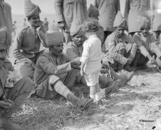 A Young French boy introduces himself to Indian soldiers who had just arrived in France to fight alongside French and British forces in First World War, Marseilles, September 1914 World War One, First World, Indiana, French Boys, French Army, Photo Souvenir, Indian Army, Rare Pictures, Ww1 Pictures