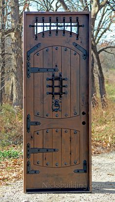 Medevil Exterior Door with glass and iron and nails Fortress doors