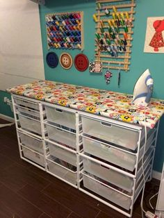 station with lots of fabric storage.ironing station with lots of fabric storage.ironing station with lots of fabric storage.