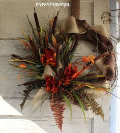 Fall Grapevine Wreath with Burlap, Cattails, Peonies, and Fall Foliage. $39.99, via Etsy.