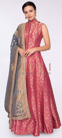 Buy Online from the link below. We ship worldwide (Free Shipping over US$100)  Click Anywhere to Tag Pink brocade anarkali dress paired with grey georgette dupatta in weaved butti only on Kalki Pink brocade anarkali dress in floral motif.Comes with a stand up round collar having potli buttons enhancing the plackets.Also comes with a matching lycra pantPaired with a contrasting grey georgette dupatta with weaved butti and border