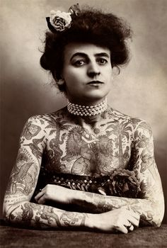 tattooed-woman-1909. The tattoo artist was Gus Wagner, her own husband. He was said to have more than 200 tattoos. Mrs Wagner, seen here, was also a contortionist. They were both circus performers.