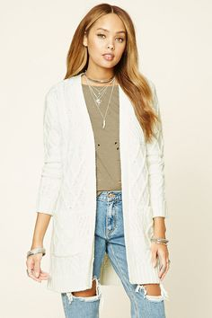 A midweight cable knit cardigan featuring a longline silhouette, open-front, long sleeves, and two front patch pockets.