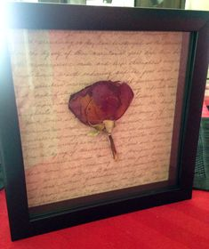 First rose my SO ever gave me, flattened and dried. Glued to scrapbook paper and placed in a shadow box as an anniversary gift