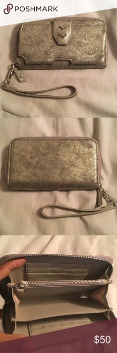 Stella and Dot Tech Wallet This brand new tech wallet can be held as a wristlet and has many slots for your credit cards and money. This wallet can also hold your smart phone (iPhone 6 plus shown in pic 4). Stella & Dot Bags Wallets