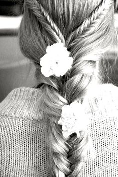 Braid with flowers hairstyle.