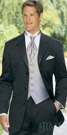 Similar to the suit my husband bought for our wedding... but I think my husband is better looking. :)