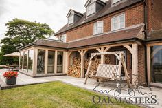 Large oak framed orangery style extension - Oakmasters - Large oak log store adds character to the rear of the house Orangery Extension Kitchen, Orangerie Extension, Cottage Extension, House Extension Design, House Design, Extension Ideas, Garden Room Extensions, House Extensions, Pergola Patio