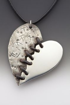 Mended Heart Necklace: Hearts can break,     hearts can mend, and love is stronger in the end.