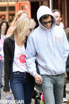 Emma Stone and Andrew Garfield are adorable. I wish that I had a relationship like theirs. She looks so happy with him. As long as they are both happy, that is all you could ask.