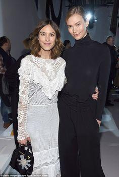 Turning heads: Alexa Chung- posing alongside supermodel Karlie Kloss, attended the Calvin ...