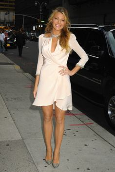 Blake Lively's fabulous cream mid sleeved frilled hem dress.