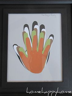 I selected different colors of scrapbook paper and then traced each of our hands. I cut out each hand and then flipped it over so you couldn't see any of the pencil marks. Lastly I just arranged them how I wanted, glued them in place and popped it into a picture frame.