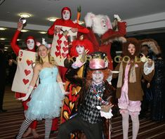 Alice in Wonderland characters to hire for corporate events.  Mad Hatter Lookalike, Red Queen, Red Card Stilt, Bouncy White Rabbit Stilt, Crystal Ball Red Card, Alice and Mad March Hare.
