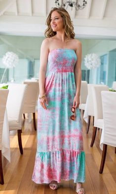 Pretty Tie Dye Maxi Dress is the perfect dress to wear this summer at home. This bandeau designer holiday dress is a a stunning pink and turquoise tie dye print designed by Lindsey Brown Resort wear Summer Holiday Dresses, Pretty Sandals, Short Beach Dresses, Clothes Steamer, Strapless Dress, Maxi Dresses, Holiday Wardrobe, Resort Wear, Silk Dress