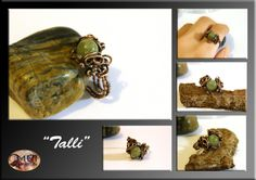 Talli- wire wrapped ring by mea00 on deviantART