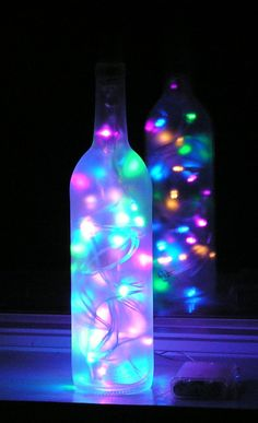 My neighbor drinks wine and gave me tons of empty wine bottles-this is a great idea! Christmas Crafts with Wine Bottles Wine Bottle Art, Lighted Wine Bottles, Bottle Lights, Wine Bottle Crafts, Bottles And Jars, Glass Bottles, Diy Bottle, Water Bottles, Perfume Bottles