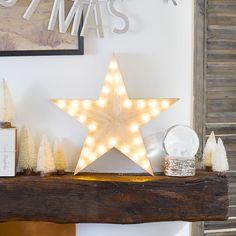 Dieser leuchtende LED-Stern aus Holz ist besonders gut für eine winterliche Hochzeitsdeko oder für die Festtage geeignet