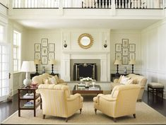 Absolutely love the arrangement of 7 framed items on either side of fireplace