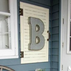 This DIY monogrammed wall sign is a quick and cute way to distinguish your home from the rest of the block!