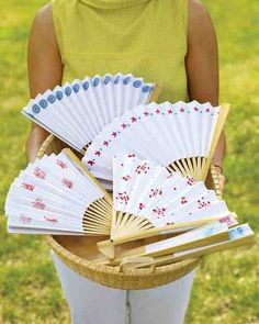 Craft a Paper Fan  At a late-summer picnic or barbecue, these easy-to-make fans keep guests cool. They also make an appreciated party favor.