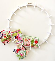 hanging Christmas cards - clothespins on an embroidery hoop... made it this year.. worked and looked great