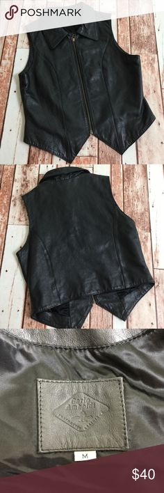 Carlo Amboldi Black Leather Vest This is a moto style, motorcycle rally or festival ready black leather vest from Carlo Amboldi. Approx. measurements: 17.5 in armpit to armpit, 21.5 shoulder to bottom of vee, 17.5 shoulder to bottom of back hem One small white mark by zipper (pictured) (1137) Carlo Amboldi Jackets & Coats Vests
