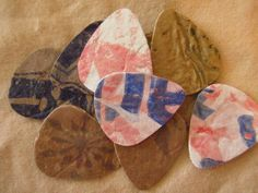 Guitar picks made from recycled fused plastic grocery bags.