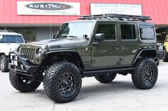 2015-jeep-wrangler-unlimited-rubicon-aev-poison-spyder-roof-rack-driver-three-quarter