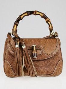 Gucci的棕色鹅卵石皮革新竹中等手提包
