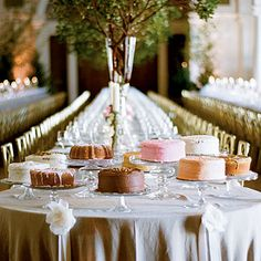 Wedding Cake Buffet Table | Instead of a multitiered cake, this bride choose different flavors from a local bakery. A great cost saver that makes a pretty display.