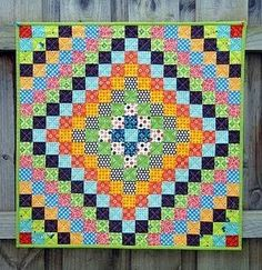 singing with birds: Five On Friday. Trip around the world quilt.  Love the polka dots.
