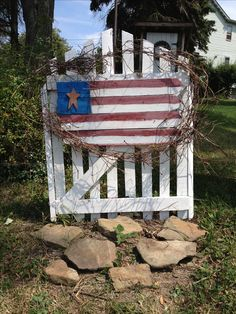 Fence post repurposed to a flag. Small 99 cent star from craft store. Grapevine from my arbor. Old gate repainted ta dah. Easy craft.