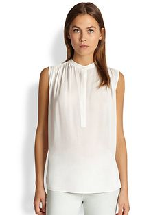 A sleeveless blouse that looks great for date night and the office.