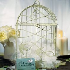This decorative birdcage is an incredible addition to your reception. It can be incorporated into a variety of themes including vintage and love bird. The birds in flight add whimsy to this already classy design. Use it as wishing well, or simply as an integral part of the décor. Available for purchase online http://madelinesweddings.weddingstar.com/product/modern-decorative-birdcage-with-birds-in-flight
