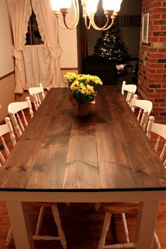 Like the planks (Hard to clean?). Also like the wood color on top with off-white around base, on chairs. Don't like the chairs here though.