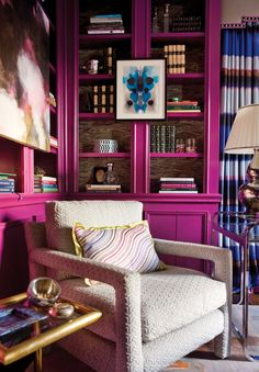 wowzer! mulberry pink lacquered library and ink blot artwork. lee jofa fabric by kelly wearstler on pillow. interior design by lindsay coral harper interiors